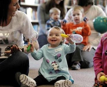 Thirteen-month-old Ayla Hibbard participates in the Move and Groove program for pre-schoolers with her mom Jessica at the Saugus Public Library in Saugus, Mass. Friday, Feb. 10, 2012. (WINSLOW TOWNSON FOR THE BOSTON GLOBE)